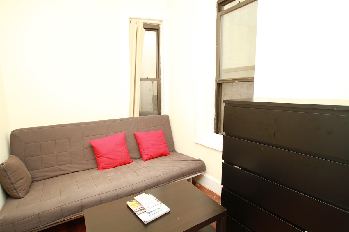 Photo 4 - Room two as living room with futon, coffee table and 6 drawer dresser - photo taken by airbnb