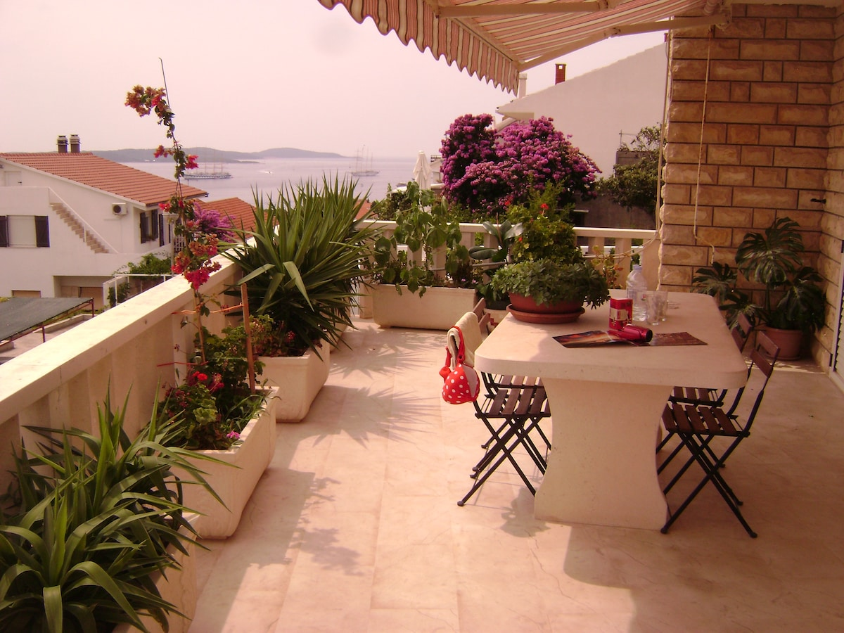 large terrace with marble table   with a beautiful view of the sea