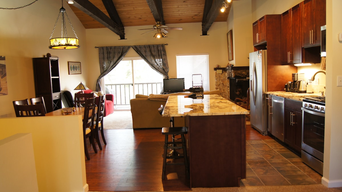 Open floor plan with large kitchen island and bar stools