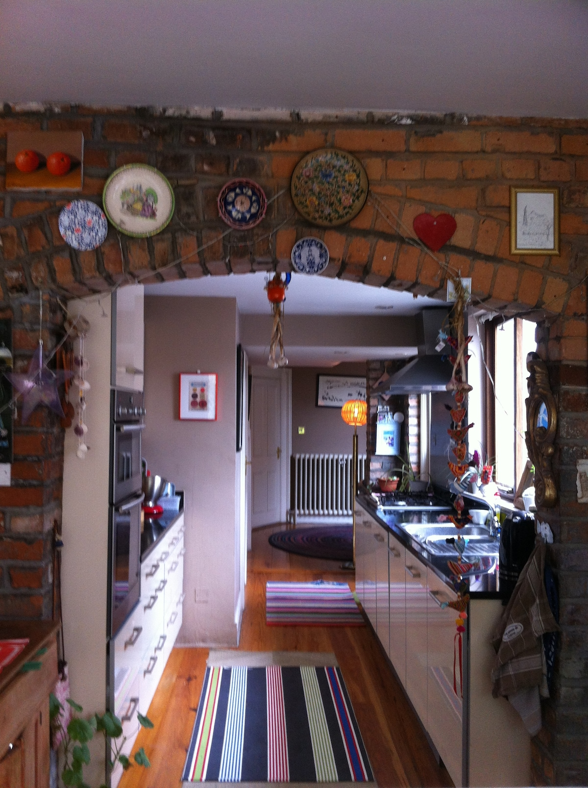 Open plan kitchen and living with double doors to garden