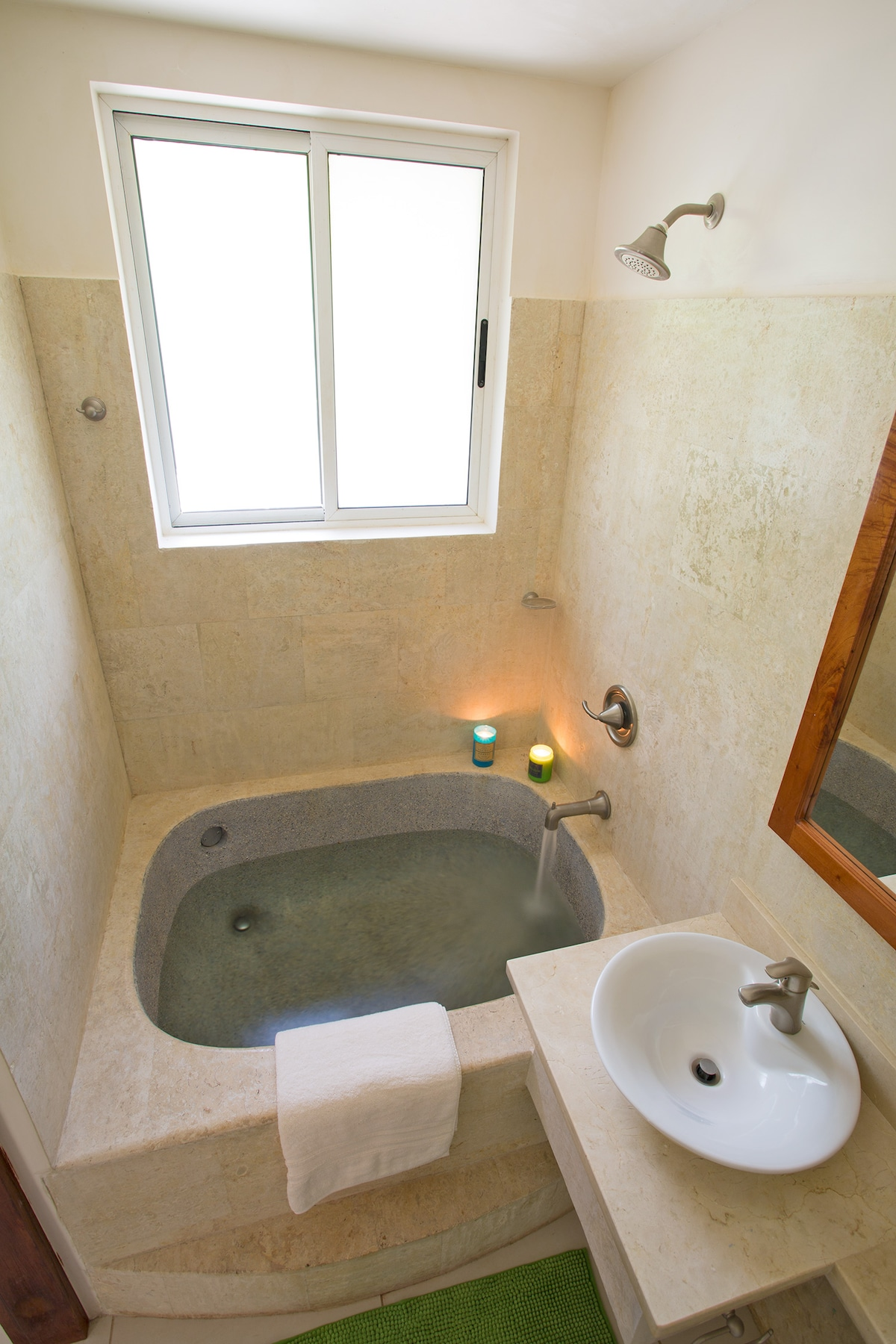 When in Costa Rica take a bath like a Roman... : ) Coral tiles and marble counter tops.