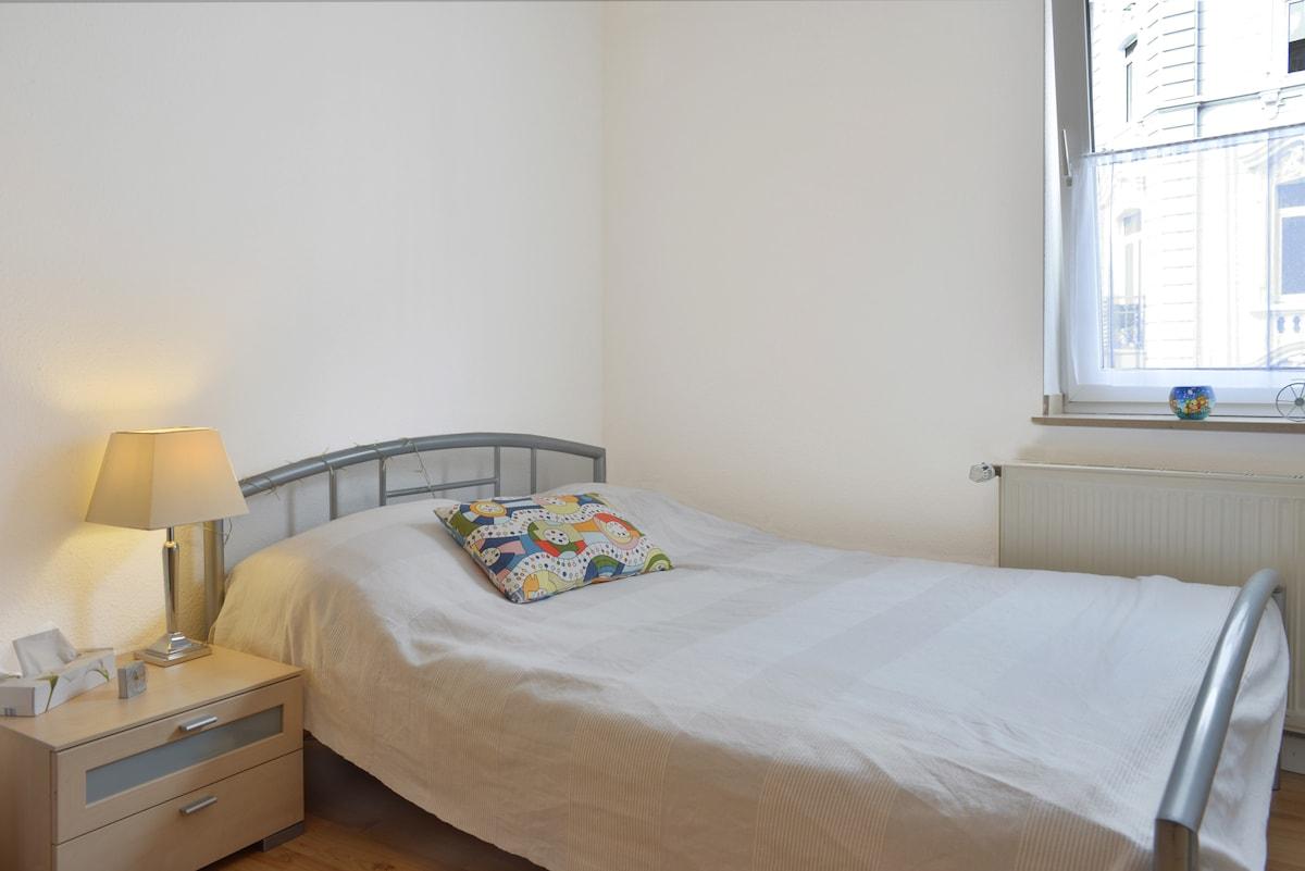 Cozy bedroom in spacious apartment