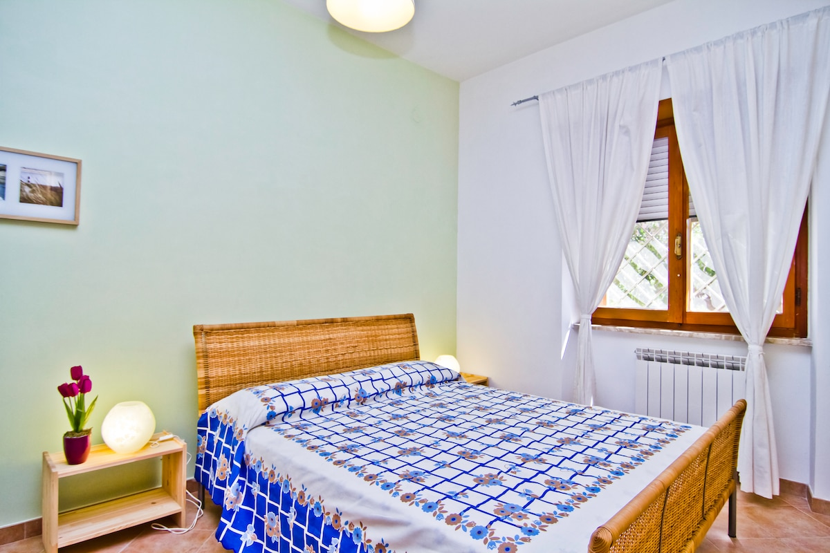 Our double room with a large table where you can have your breakfast, write and read