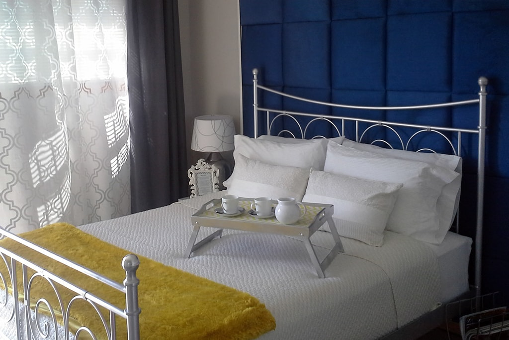 Your private master suite has a comfortable queen size bed, featuring crisp sheets, plush blanket, and soft pillows.