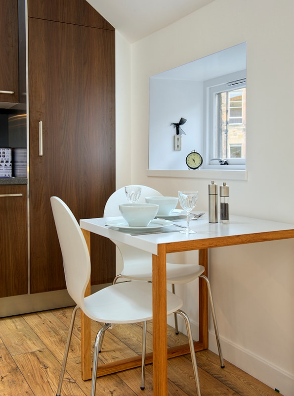 Eat in a dining area that looks out onto a cobbled lane in the city centre.
