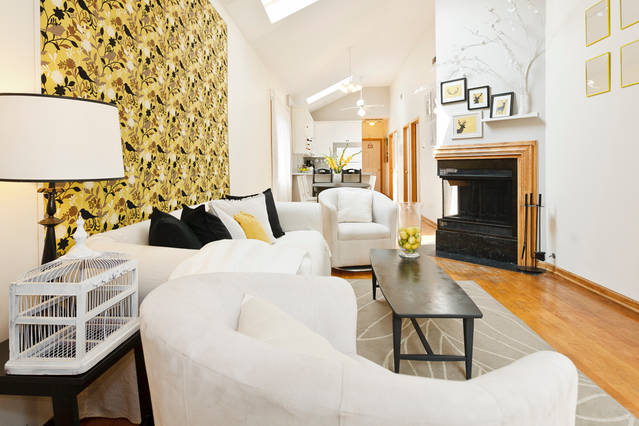 Our top-floor apartment is very spacious and bright with vaulted ceilings, skylights, and wood burning fireplace.