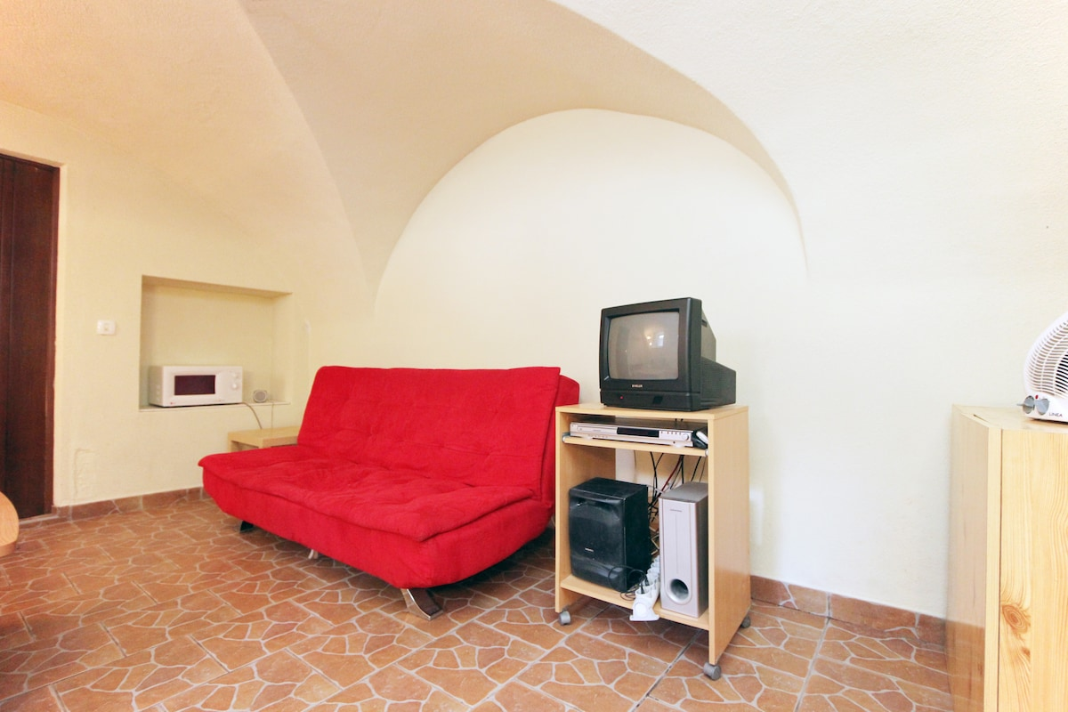 Living area. Microwave oven in alcove.