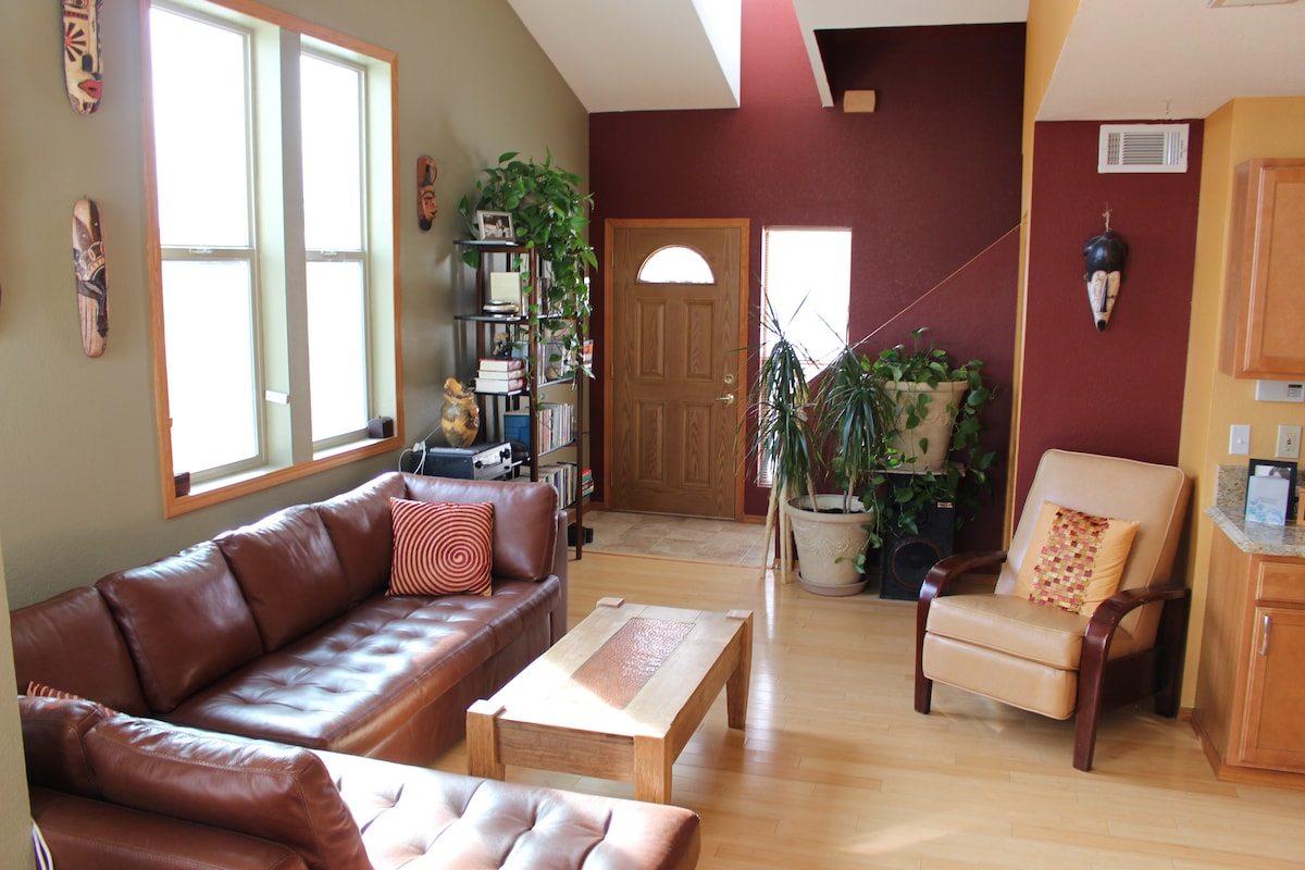 The living room; we now have beautiful wooden blinds throughout the house for greater privacy.