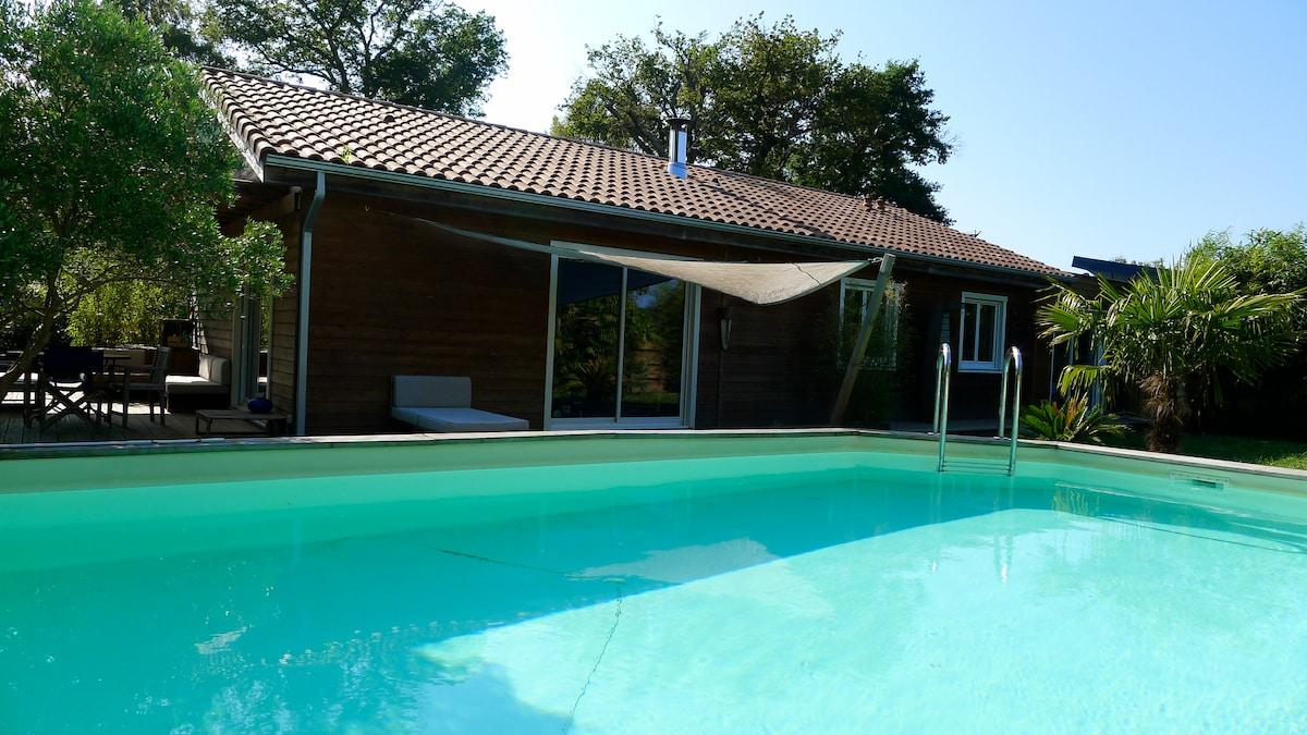 Maison bois avec piscine chauffée