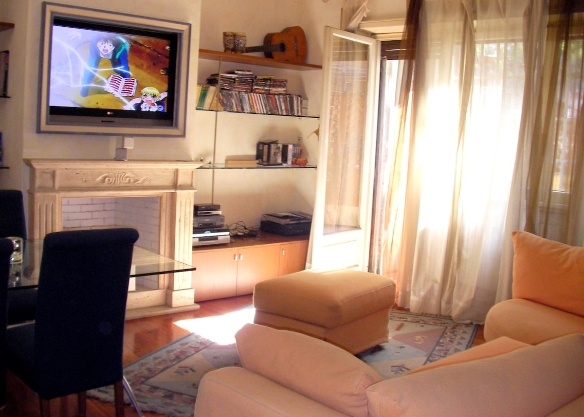 The living area, the big sofa with view on the 42'' flat tv