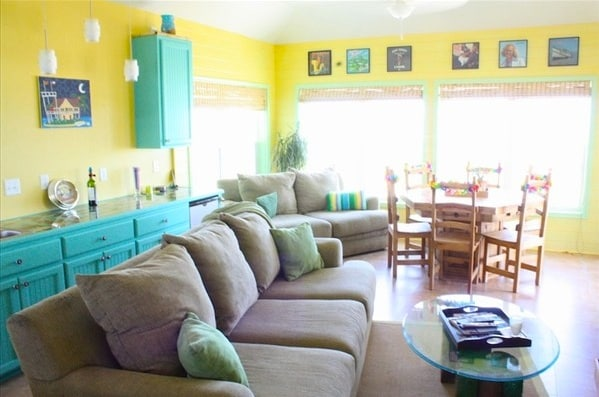 Living/Dining Room with 2 couches, wet bar and LCD TV with surround sound