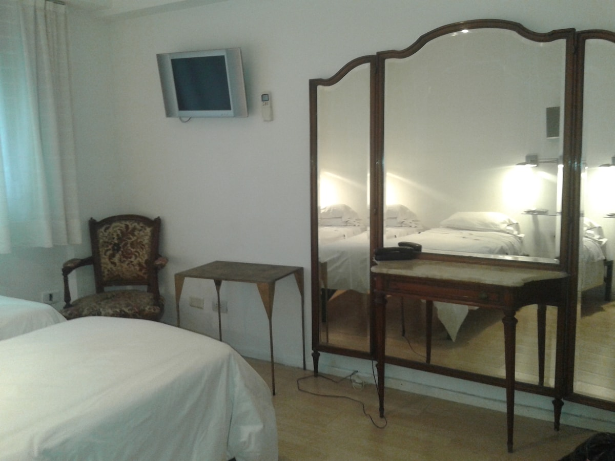 The room has two single beds that can be made as one if request!!  you can move fourniture arround   if needed.