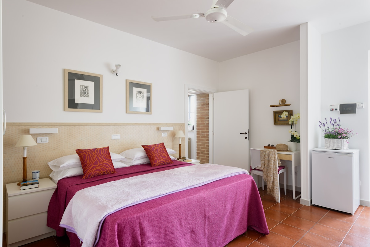 One of the two bedrooms with en suite bathrooms.