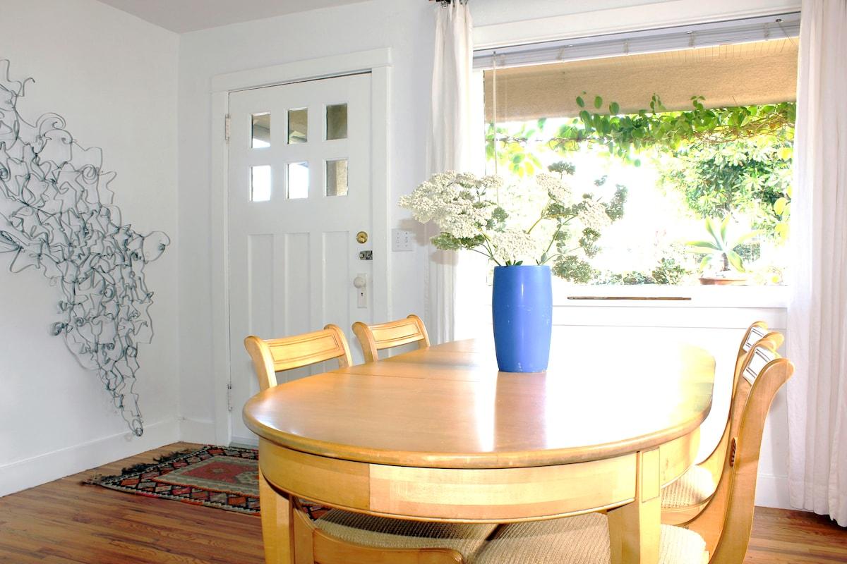 The dining room opens onto the front porch. My wire sculpture's on the wall.
