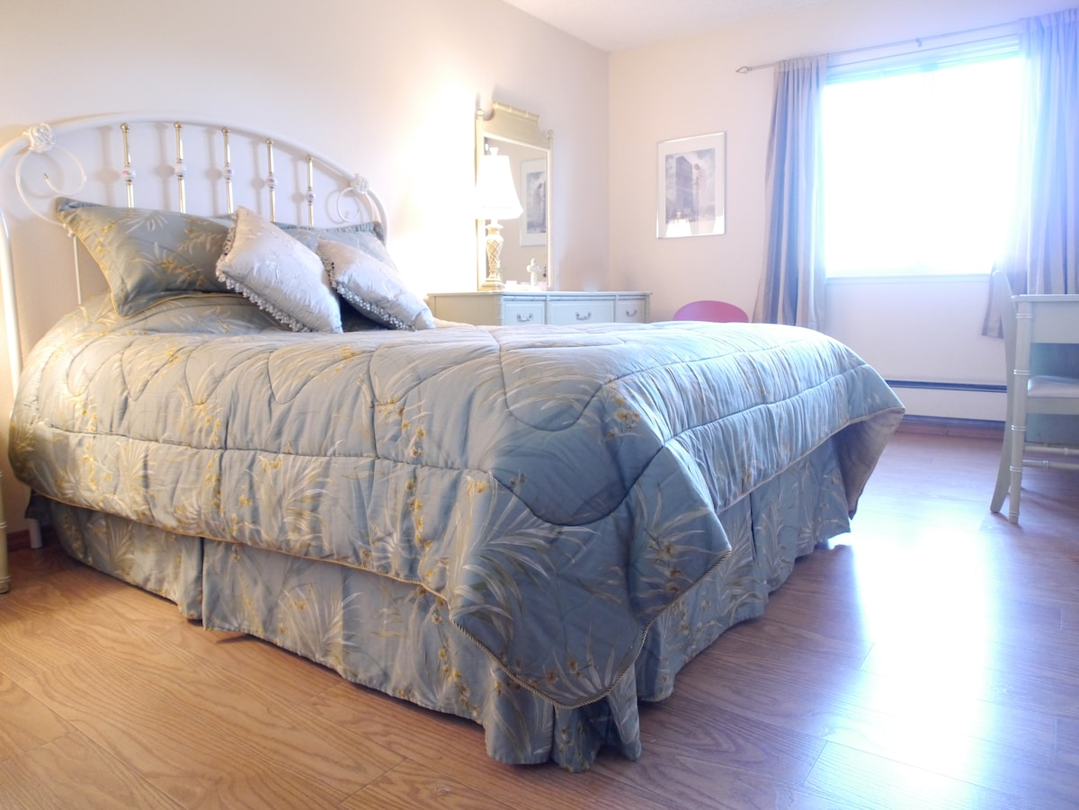 Your bedroom. Queen size bed. view looks out the front of the house.