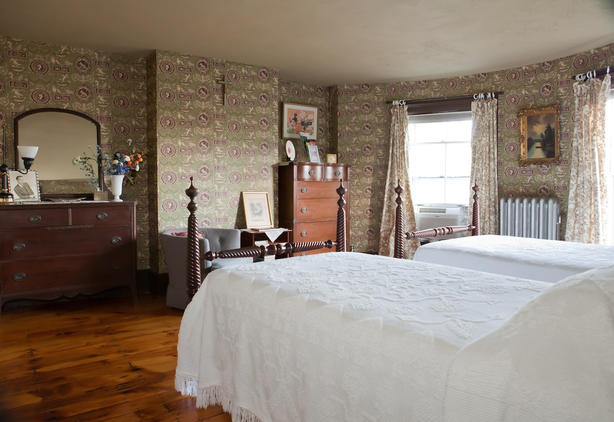 Guest bedroom: Antique twin beds, dressers and a walk-in closet.