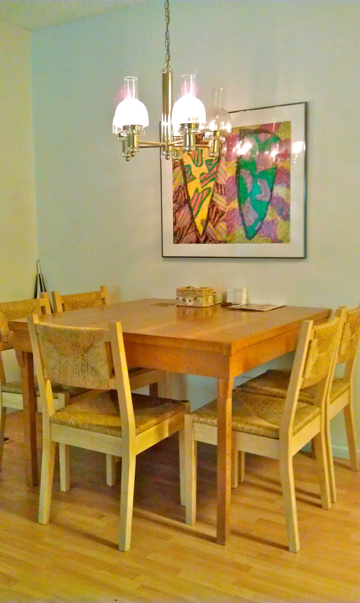 Hand-made wooden dining table easily seats five.