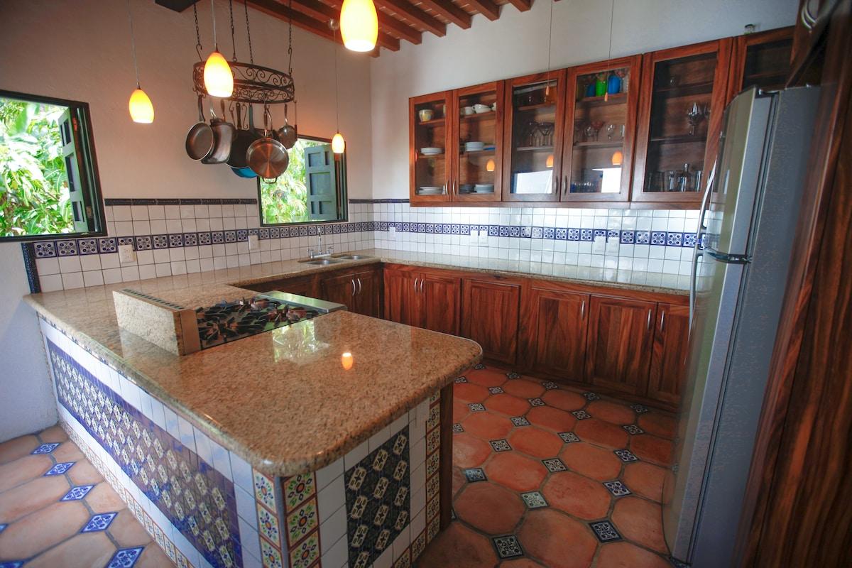 Lower House Kitchen - granite counters, talavera tile bar, perota wood cabinets