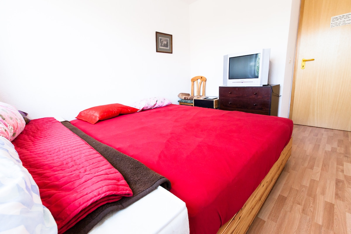 double bed of good quality, single bed, TV with DVD's in english and german