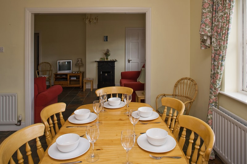 The dining room and living room in the cottage