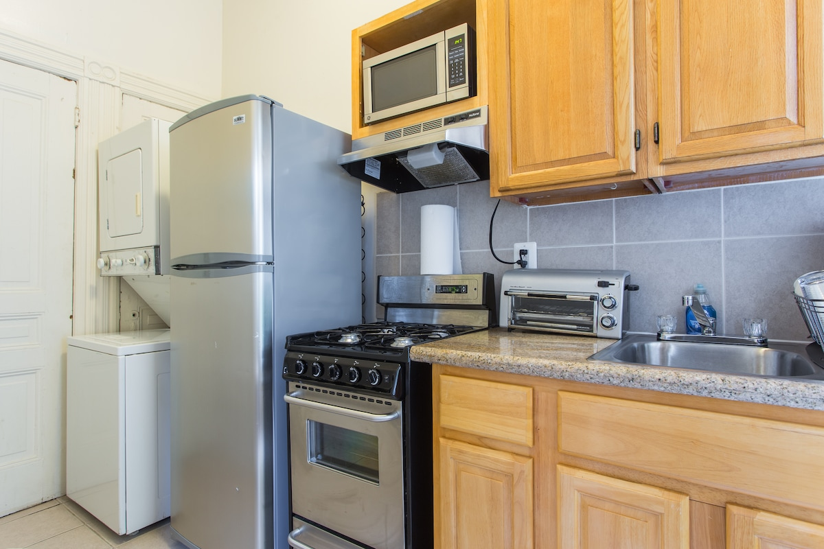 Well appointed kitchen with granite countertop and washer & dryer.