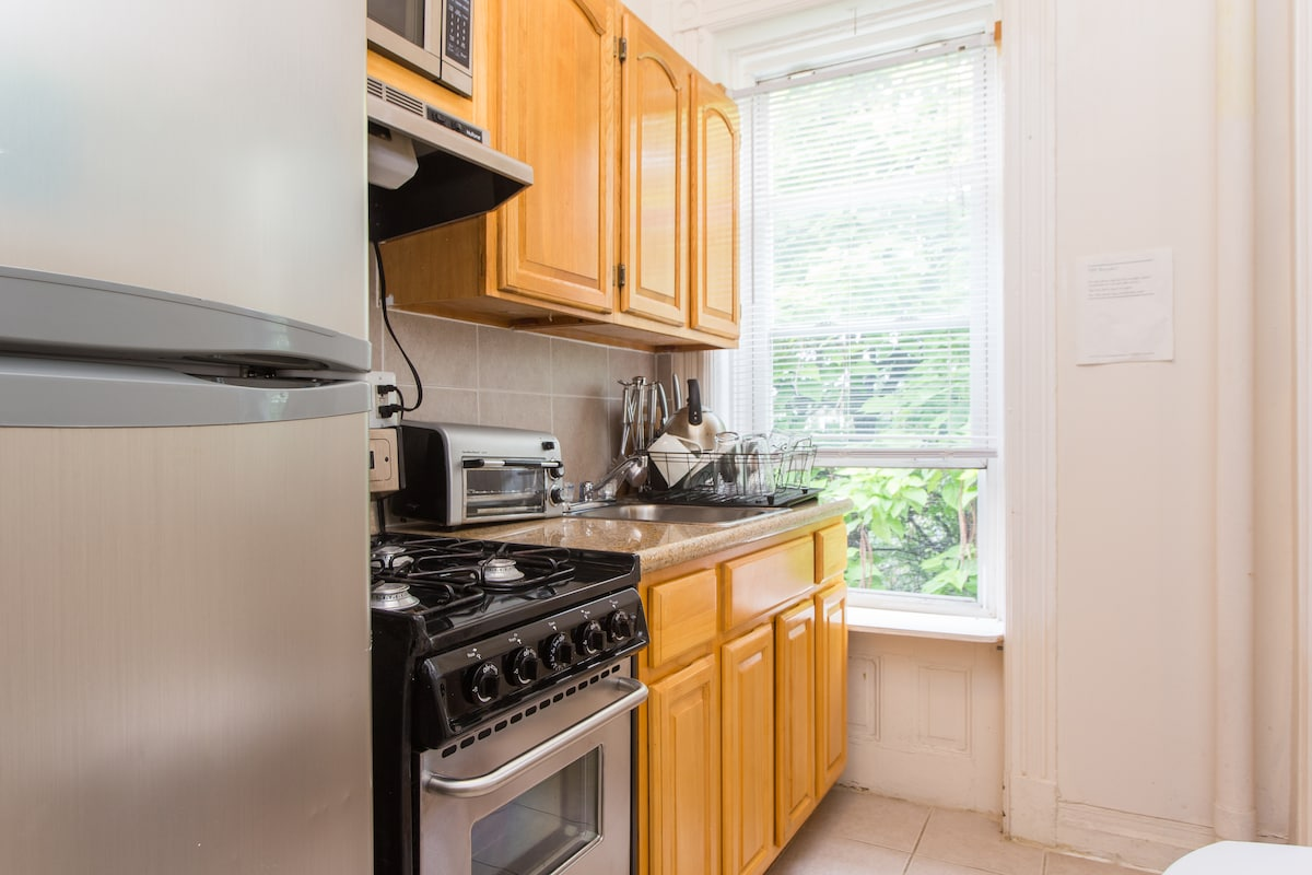 Stainless steel appliances including microwave and toaster.