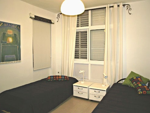 2 single beds and a wardrobe