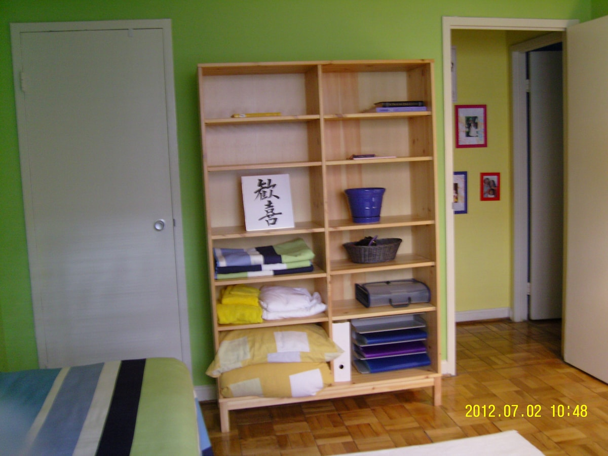 Besides plenty of space in the closet behind door on the left, shelves to keep your things organized.