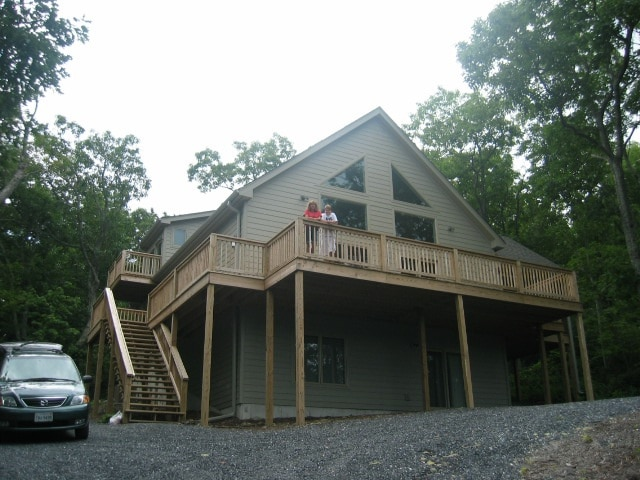 Huge wrap around deck. Upstairs balcony on left side is part of master bedroom.