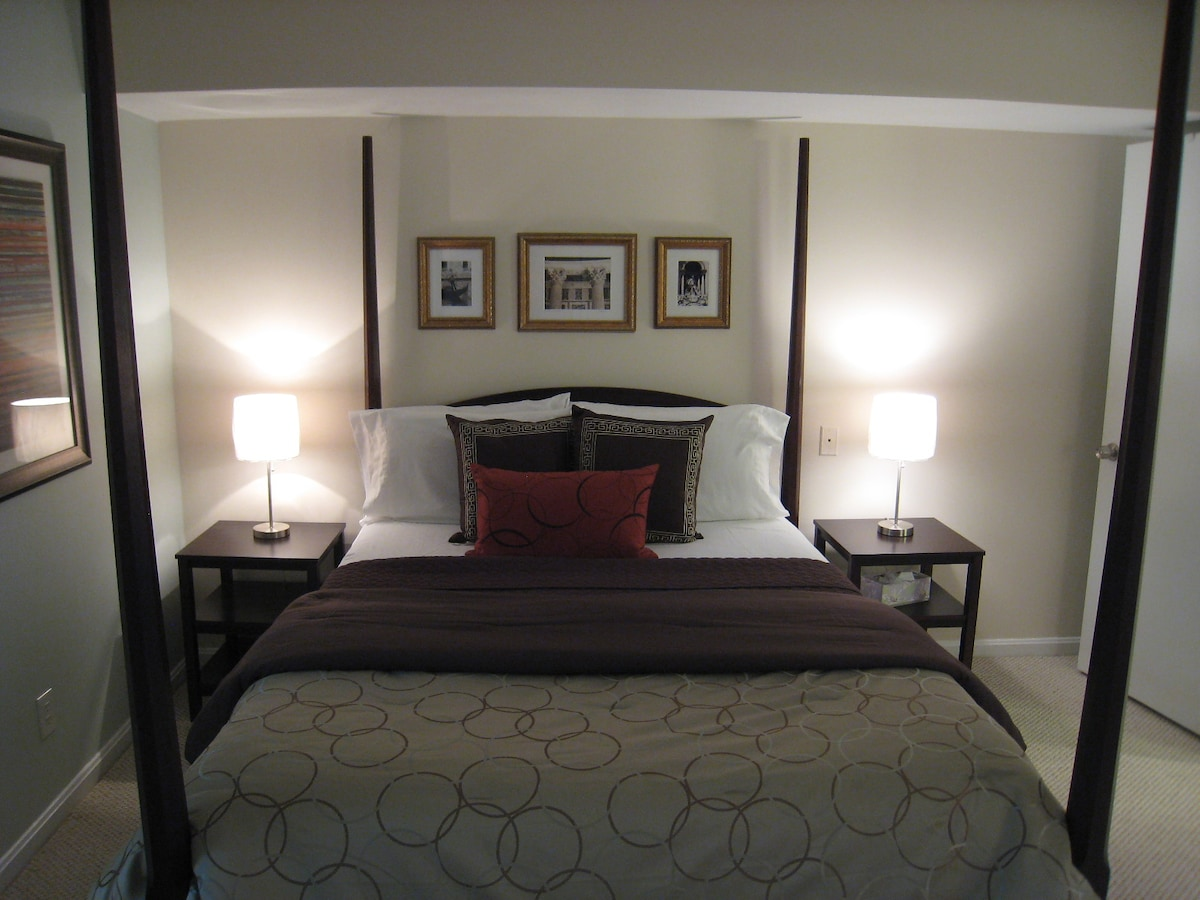Handsome, linear bedroom design with with Queen size bed