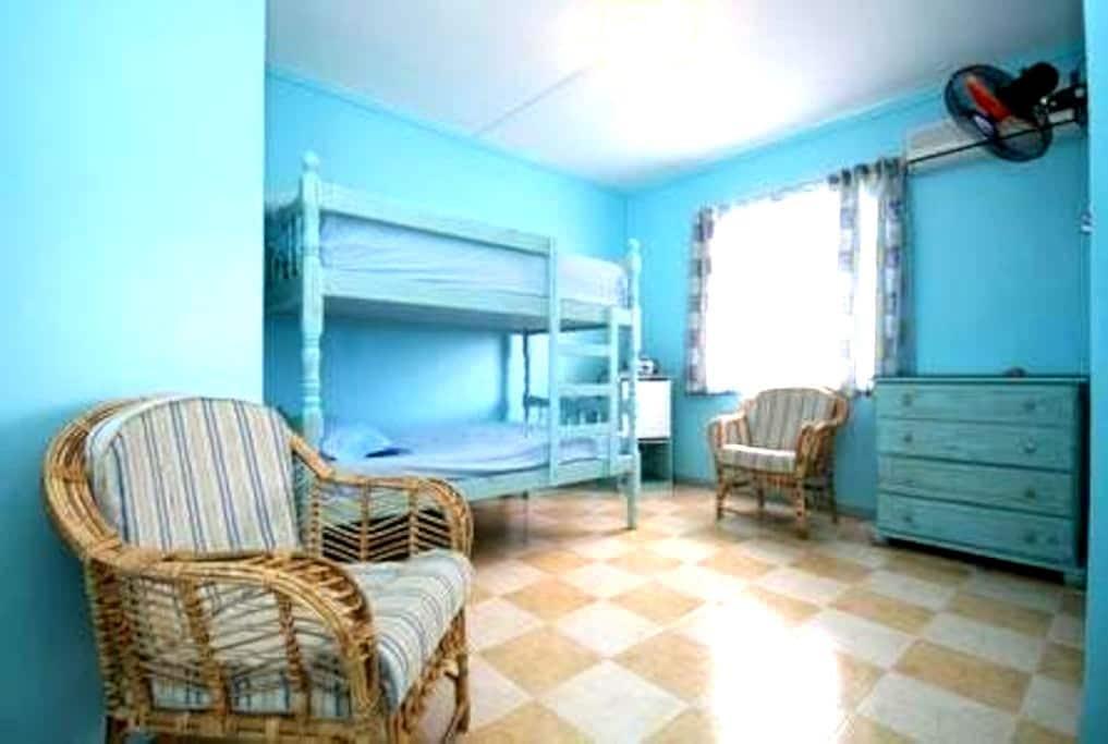 Bedroom with Bunk beds ,aircon,fan. - Blue Bay - Villa