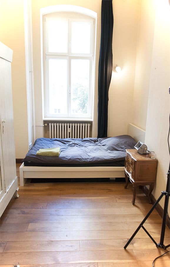 Your room with double bed, desk, wardrobe, shelves, and bedside table. Your room is at circa 20meters from mine and far from the Salon. Privacy garanteed !