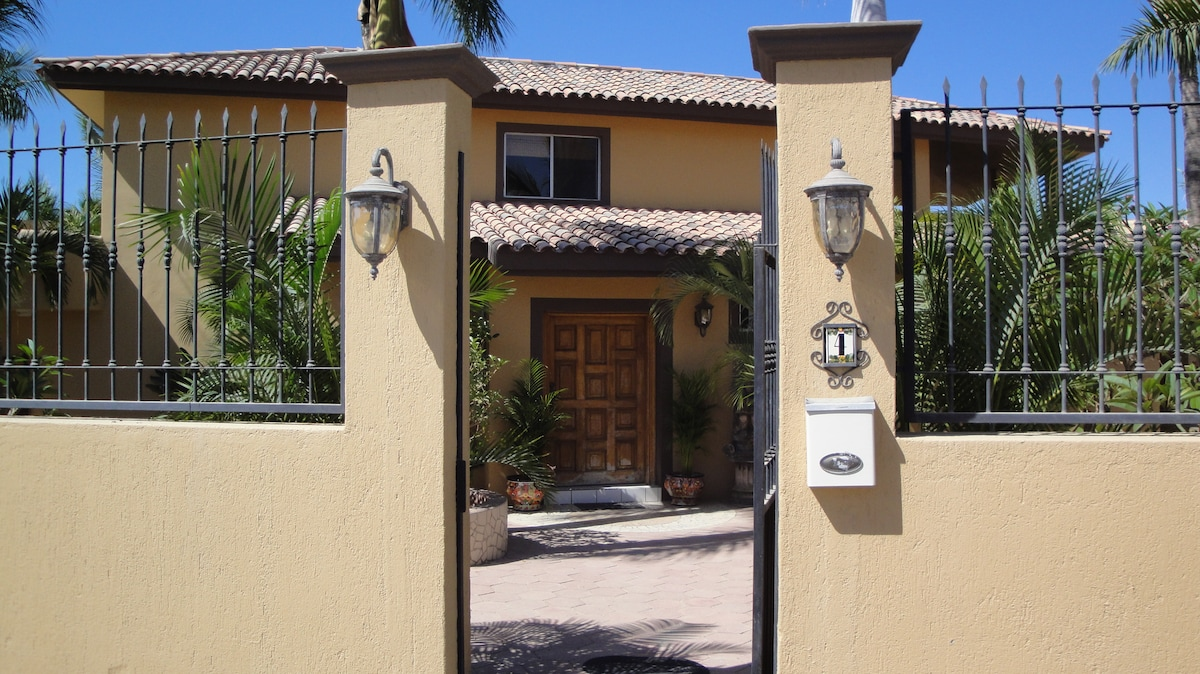 Entering the front gate - there is a gated garage to the right, so you can drive into the property and walk to the front door too
