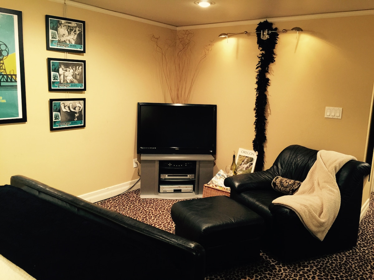 Put your feet up and enjoy our flat-screen TV, with many, many cable channels and a big selection of DVDs...