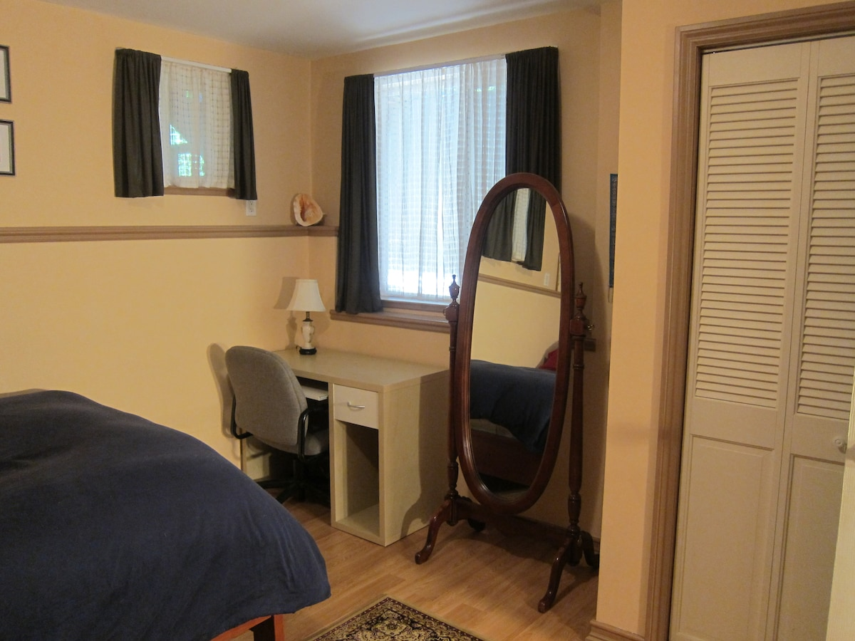 A desk for working and a full length mirror for admiring. The room also has a large closet for your clothes.