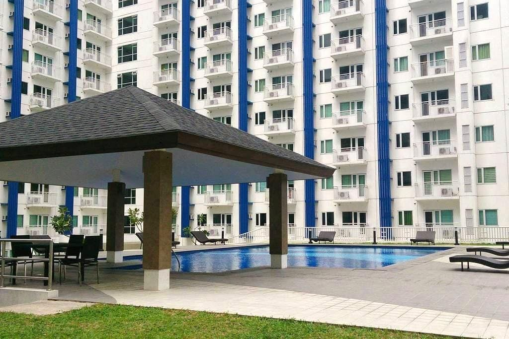 SM Condo w/ BALCONY, Wi-Fi and POOL - Quezon City