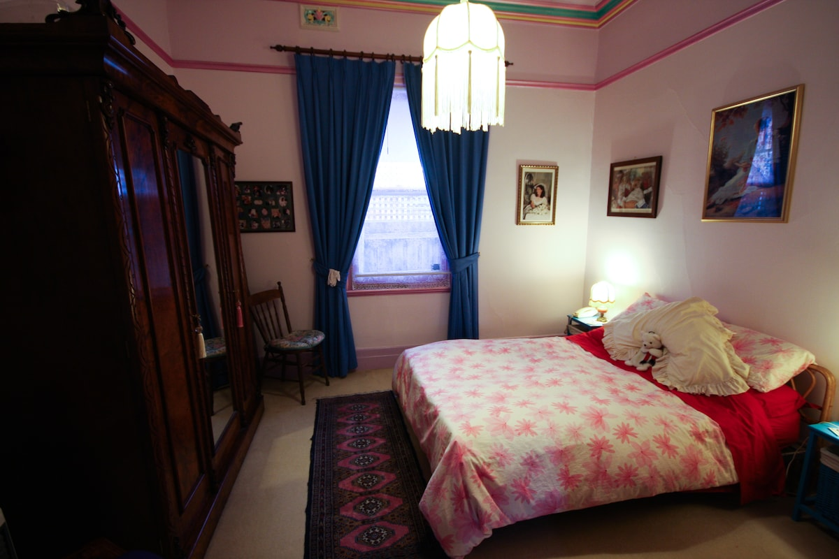 Air conditioned bedroom with double bed and plenty of storage