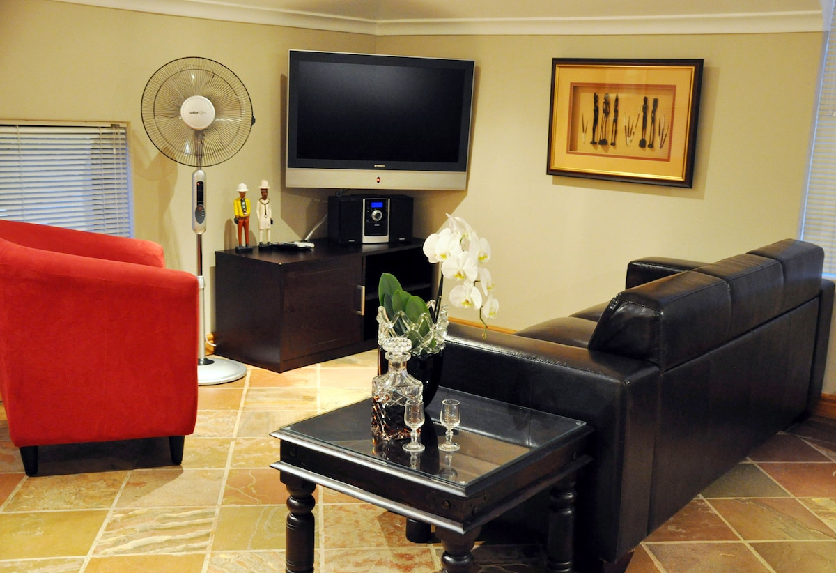 Lounge with Flat TV with Full DSTV Package and DVD Player. Wireless Available
