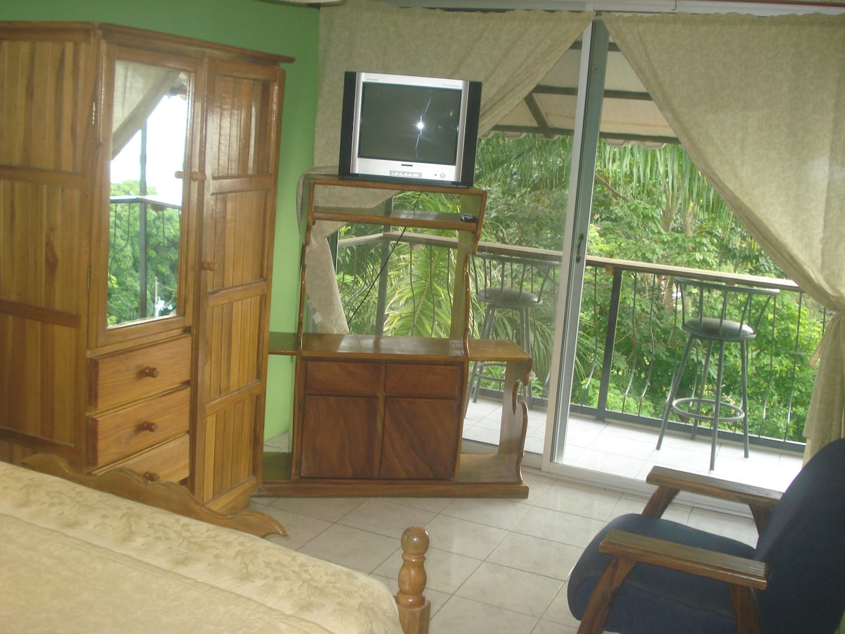 The bedroom is on the second floor, with jungle and ocean views