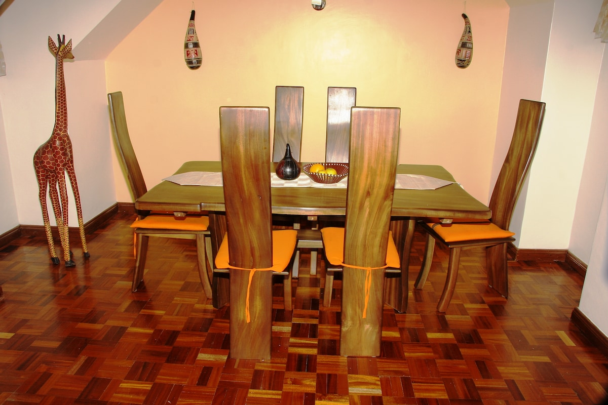 African Themed Dining Area Featuring Six piece Mahogany Dining Table