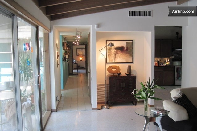 This is another picture of the entrance hallway but you can also see the pool patio door to the left and the kitchen to the right. This view is from the orange guest room, which also had a nice view out to the pool.