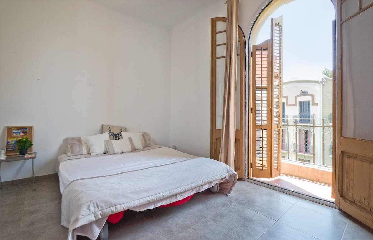 Sunny Bedroom with Private Balcony