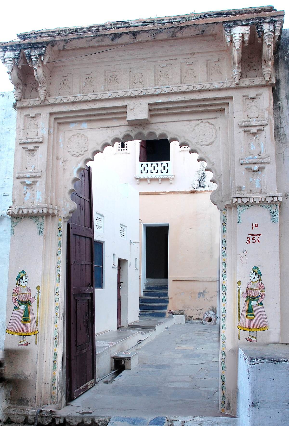 Elephant Gate- 250 year old main entrance to the property. Big enough for the family elephant two generations back! Guest rooms are located off rear courtyard (not in view).