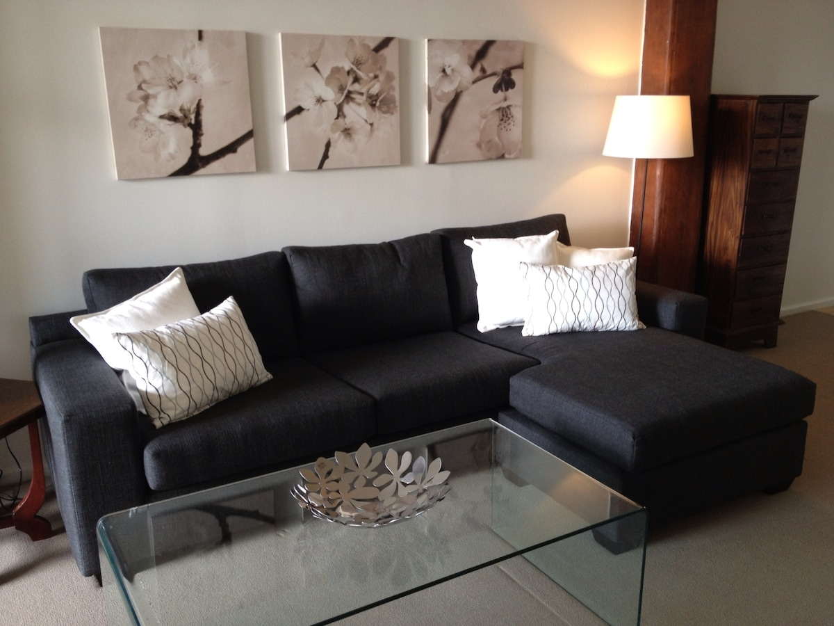 Lounge room with 3-seater chaise sofa bed