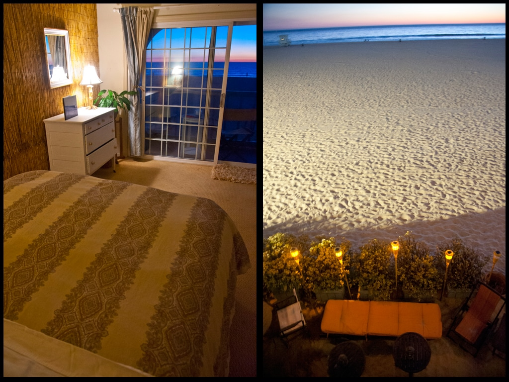 View of beach and downstairs sand patio with solar tiki torches from your bed and balcony at night.