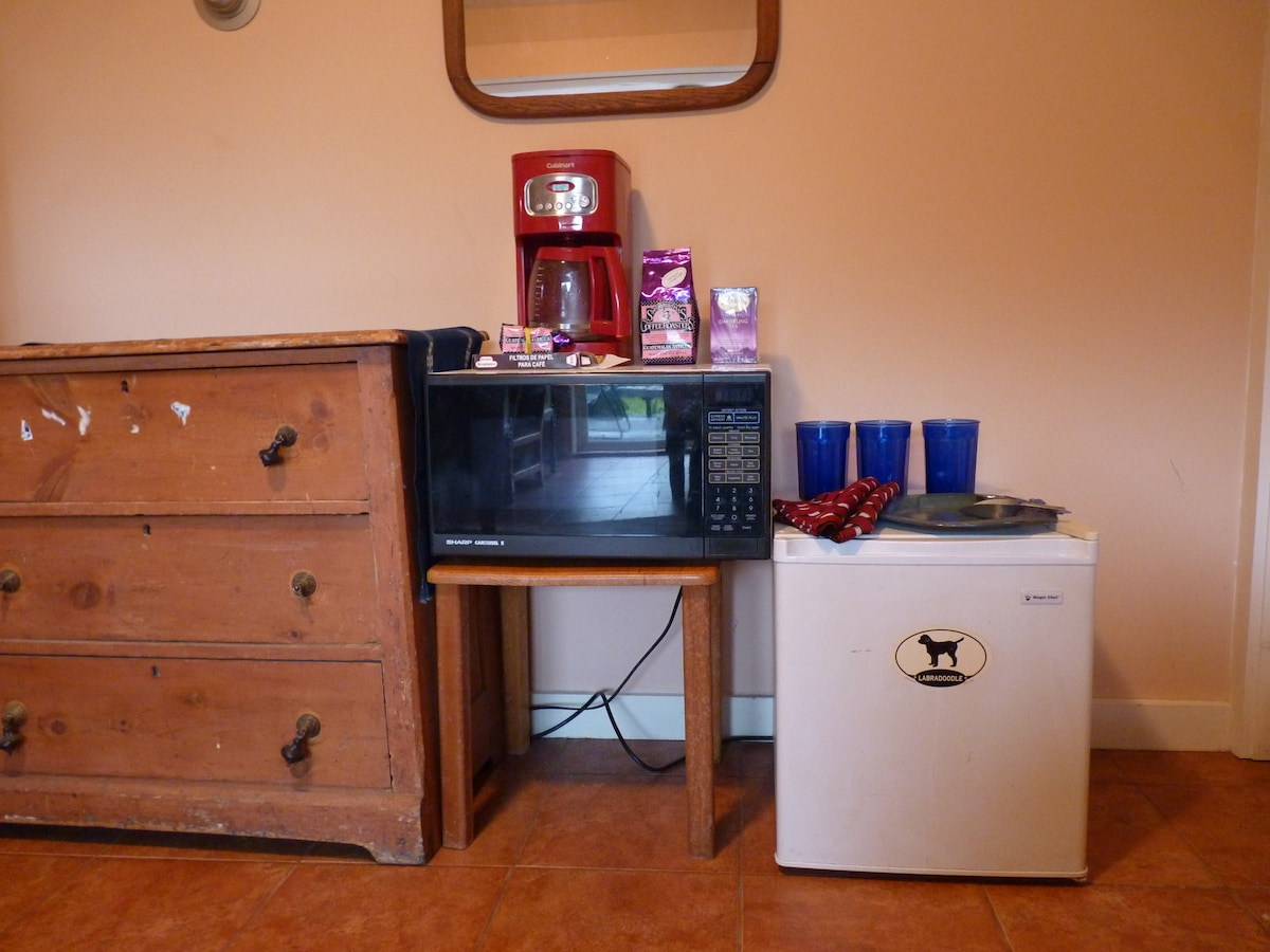 This is the small cooking area with a small fridge, a microwave, and a coffee pot for your convenience.