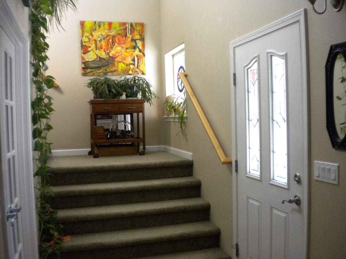 Sunny stairway leading to upstairs with guest area bedrooms.