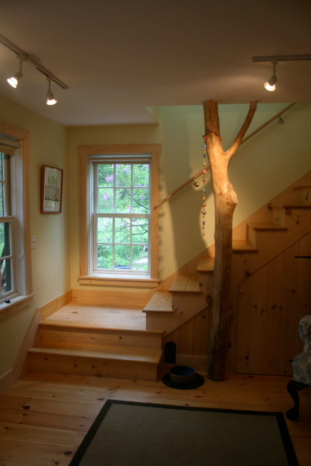 front entry and stairs to second floor (tree courtesy of our wood lot)