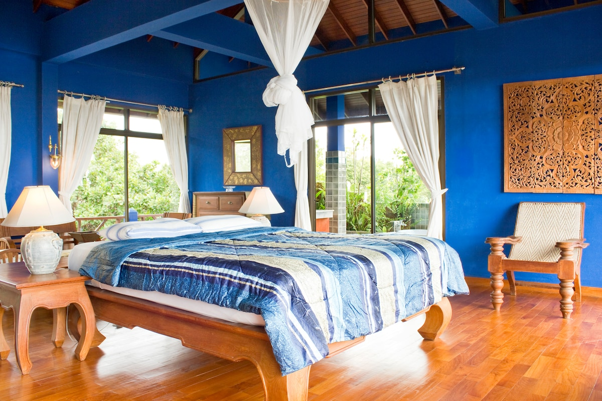 huge master bedroom with amazing views over the sea in front and mountains behind