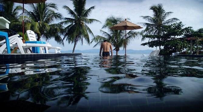 Our black-tiled pool overlooks Samui